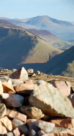 Dodd summit cairn below Red Pike looking towards the Coldale Fells and Newlands Valley