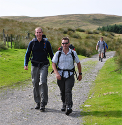 Striding out at Grovebeck Fold at the end of the Lake District 24 Peaks Challenge.